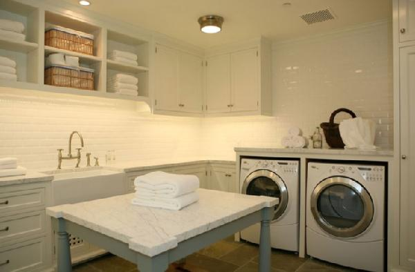 finished laundry room with island and sink