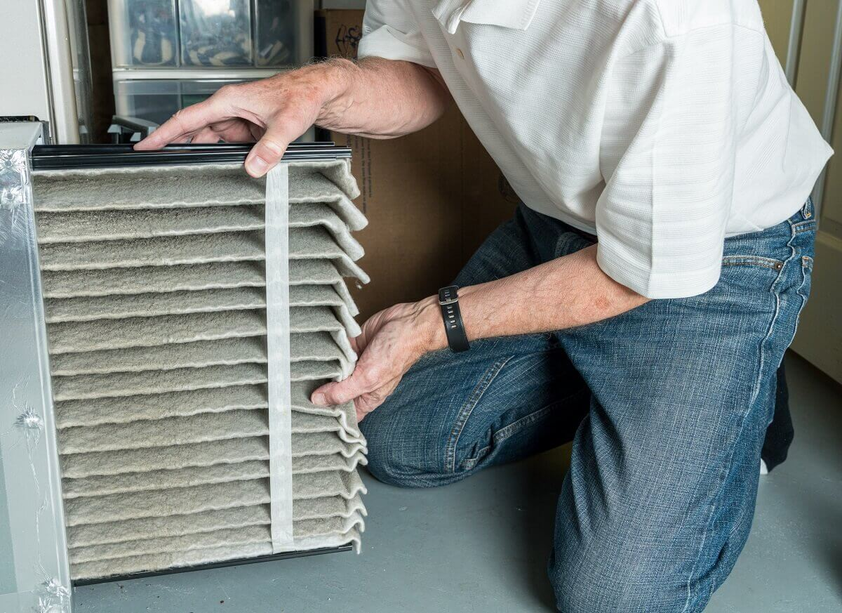 professional changing furnace filter