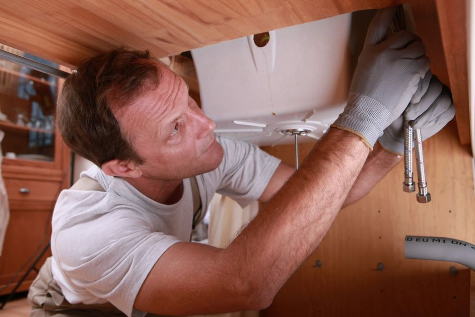 a plumber installing a sink