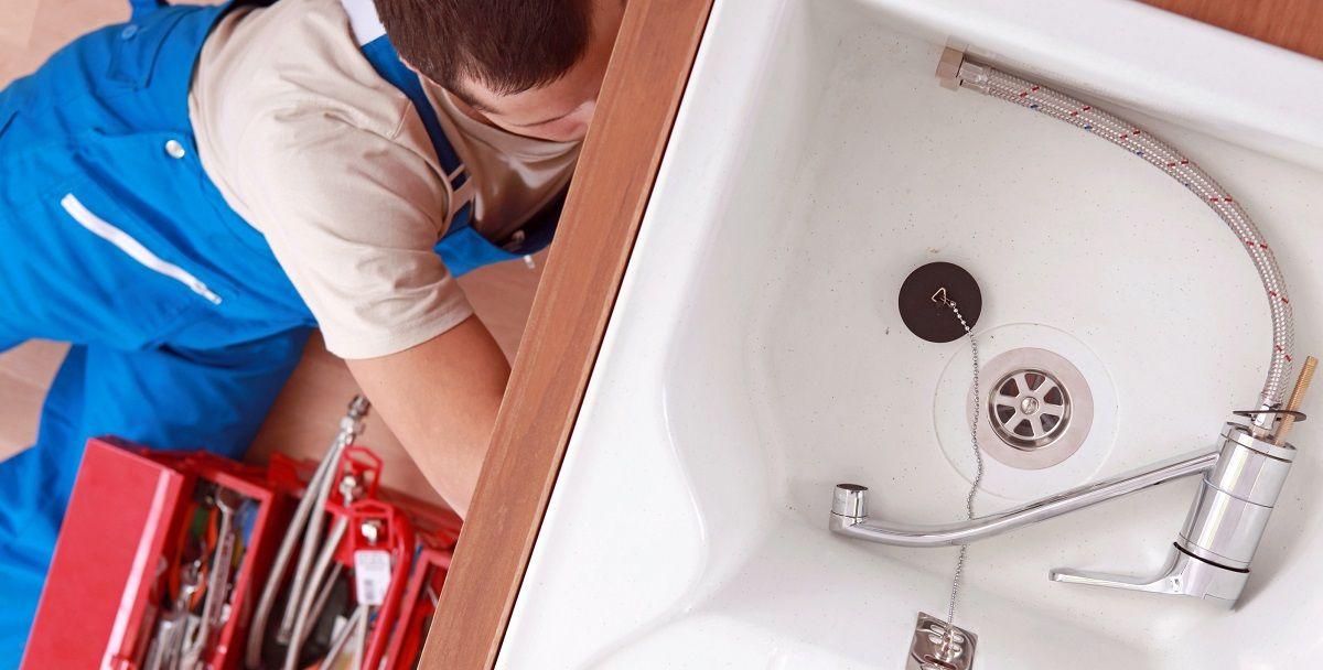 plumber installing kitchen sink