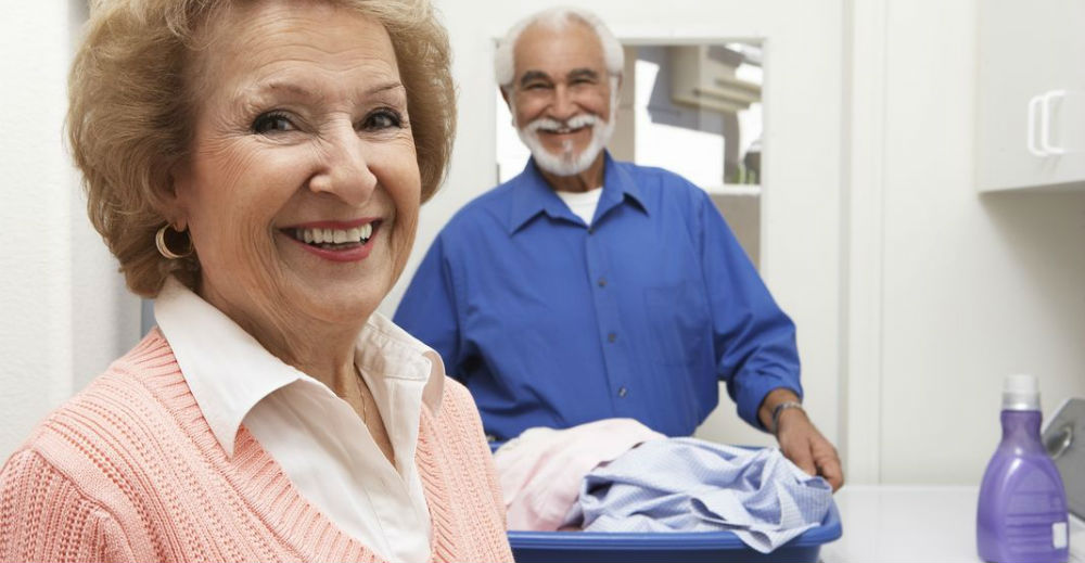 elderly couple doing laundry