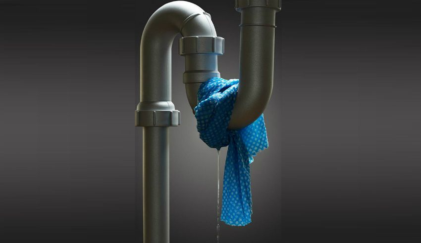 a leaking pipe wrapped with a cloth